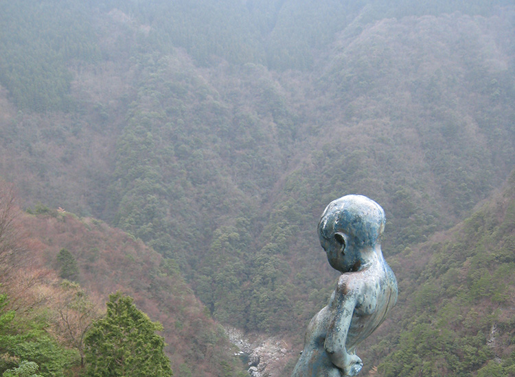 "The ""peeing boy statue"" is perched at the top of a 200-meter cliff overlooking the valley. // © 2015 Tourism Shikoku and Japan National Tourism Organization"