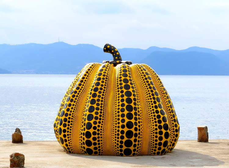 Naoshima Island attracts art lovers with its large collection of contemporary art, including this fiberglass pumpkin by Yayoi Kusama. // © 2014 Boutique Japan