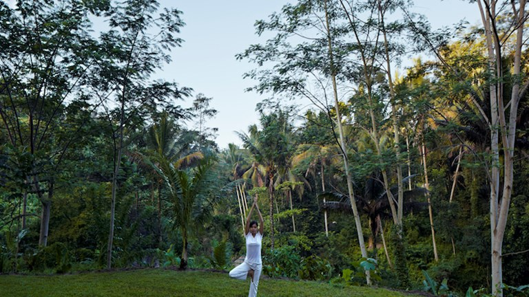 At Kayumanis Ubud, a luxury resort on Bali's Ayung River, guests can participate in outdoor morning yoga sessions. // © 2014 Kayumanis