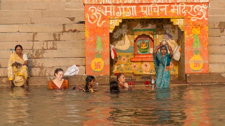 Unlike men, women must be fully covered when entering the Ganges River. // © 2014 Mindy Poder