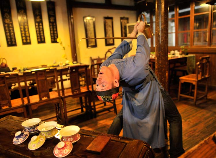 A man pours tea at a traditional tea ceremony. // © 2014 Hangzhou Tourism Commission