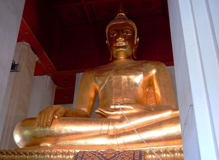 This massive bronze Buddha, called Phra Mongkhon Bophit, stands 40 feet tall and is 30 feet wide. // © 2015 Shane Nelson