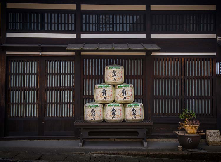 A display of sake barrels outside the showroom of the Hazama-syuzo Brewery in the town of Nakatsugawa  // © 2014 Mark Edward Harris