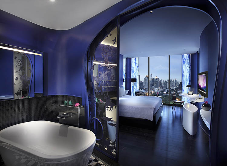 Rooms with the earth element theme feature Thai wall paintings against a brilliant-blue wall. // © 2017 SO Sofitel Bangkok