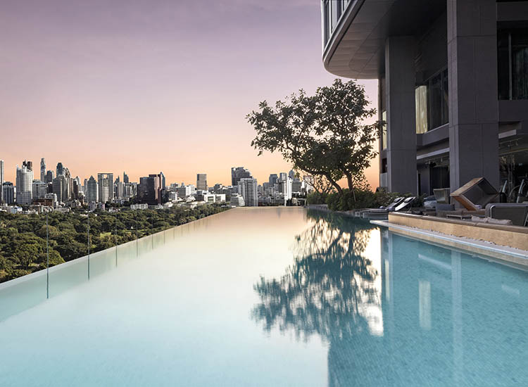 An infinity pool is located on the 10th floor and offers a panoramic vista of Lumpini Park and Bangkok's skyline. // © 2017 SO Sofitel Bangkok