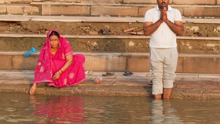 Hindus hope that their ashes are released in the Ganges River at Varanasi, though many also travel here to perform their ritual ablutions each morning. // © 2014 Mindy Poder
