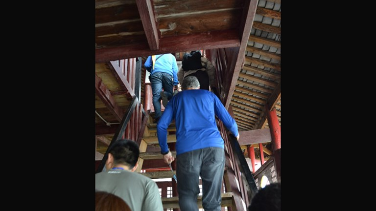 Advise clients to wear comfortable shoes and pants as the Shibaozhai excursion requires climbing uneven, rickety steps. // © 2013 Mindy Poder