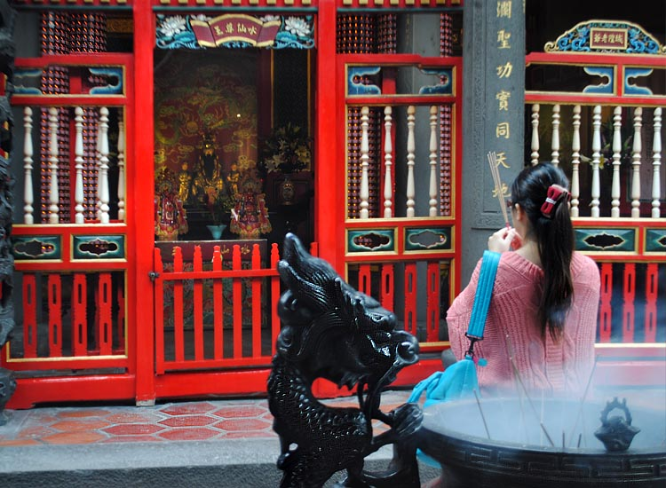 Founded in 1738, Longshan Temple is dedicated to the Buddhist Goddess of Mercy but includes Taoist deities as well. // © 2014 Mindy Poder