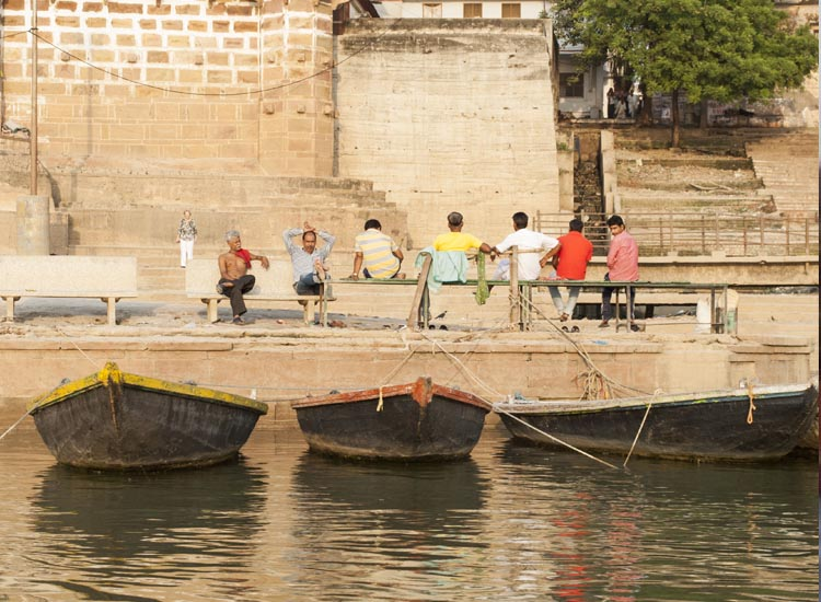 A group of men sit near the banks of the Ganges River in Varanasi // © 2014 Mindy Poder
