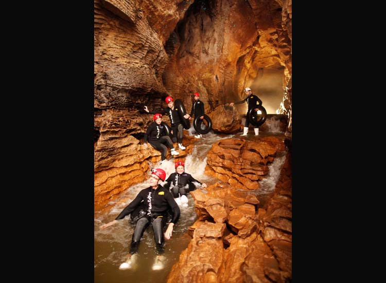 "The Legendary Black Water Rafting Co. offers adventurous tours at Waitomo Caves, such as the ""Black Labyrinth"" tour, which gives clients a chance to float, climb and splash their way through Ruakuri Cave. // © 2014 The Legendary Black Water Rafting Co."