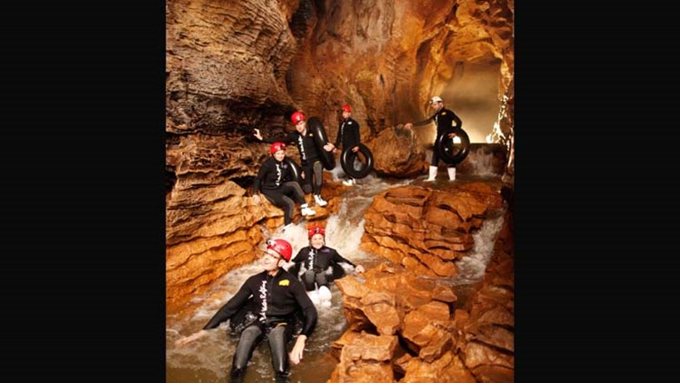 "The Legendary Black Water Rafting Co. offers adventurous tours at Waitomo Caves, such as the ""Black Labyrinth"" tour, which gives clients a chance to float, climb and splash their way through Ruakuri C"
