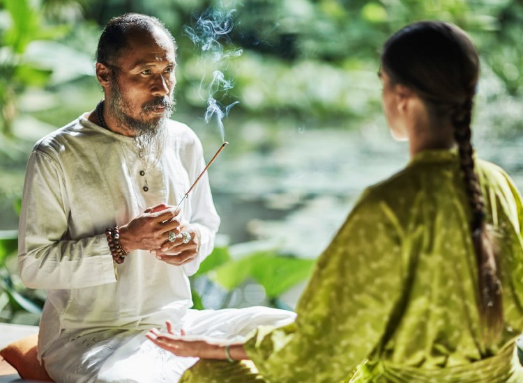A priest at his family shrine, Djik Dewa also performs energy work for  guests at