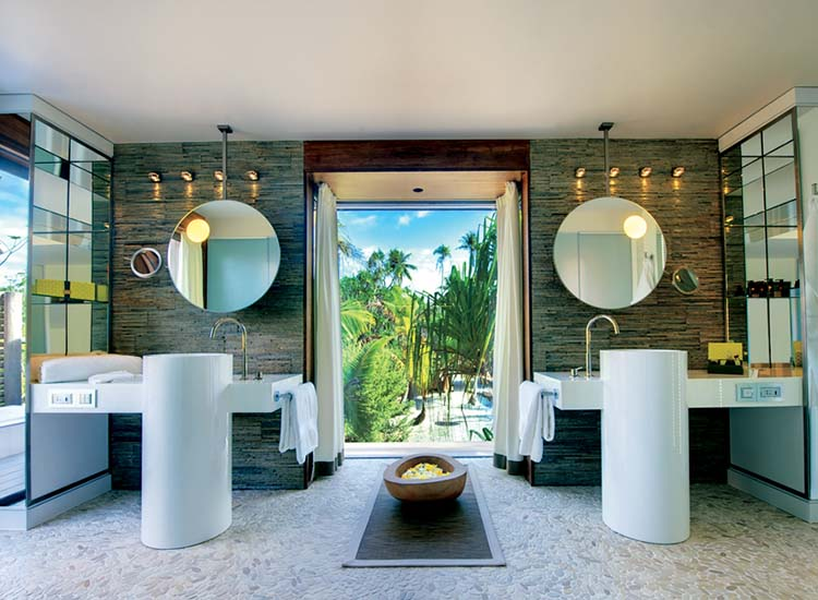 All 35 villas have contemporary bathrooms with indoor showers and outdoor soaking tubs. // © 2015 Tim-McKenna.com
