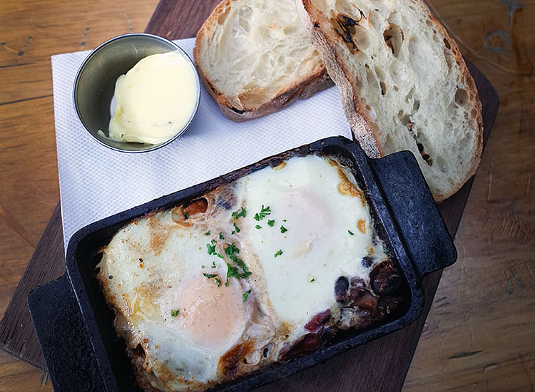 Spanish baked eggs from Fidel's Cafe // © 2016 Tovin Lapan