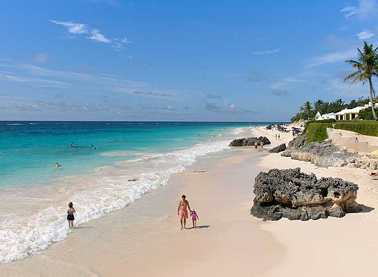 Tourists enjoy the light pink sands of Elbow Beach, Bermuda. // © 2013 Mark Edward Harris