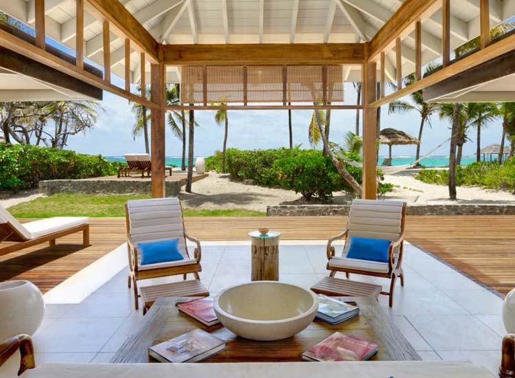 The resort's 22 luxurious cottages have modern upscale perks, including Nespresso machines and Bose iPod docks, but there are no televisions and no Internet access. // © © 2014 Petit St. Vincent