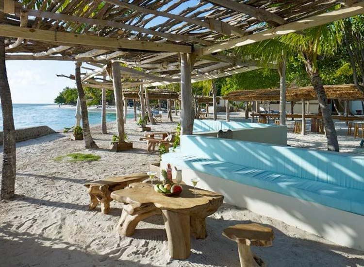 Goatie's spacious lounge in the sand encourages guests to spend a good part of the day here. // © 2014 Petit St. Vincent