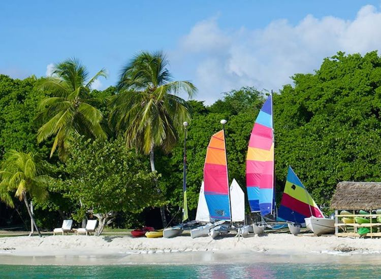 Sailboats are available for chartered trips to nearby attractions such as Tobago Cays, a group of small islands surrounded by extensive reef. // © 2014 Petit St. Vincent