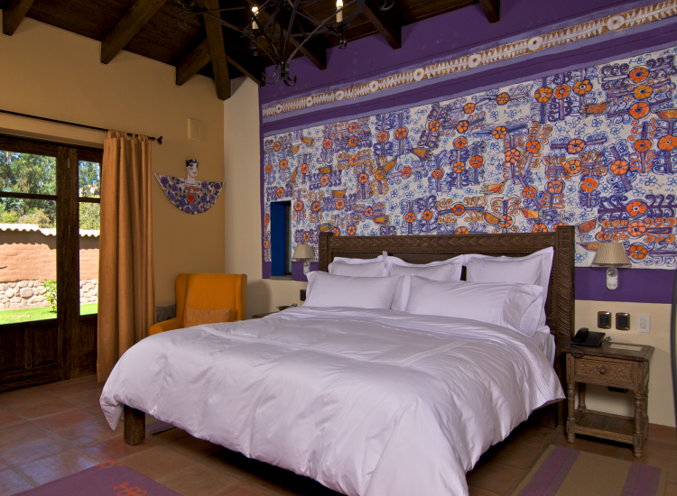 Accommodations are decorated with local art, including murals by Federico Bauer, a contemporary artist who blends motifs of nature and the Escuela Cusquena. // © 2014 Sol & Luna Lodge and Spa
