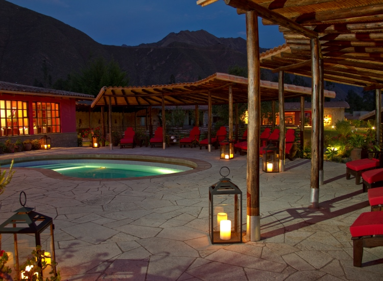 The outdoor pool provides ample outdoor seating and mountain views. // © 2014 Sol & Luna Lodge and Spa