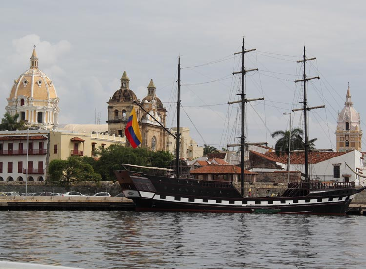 Sixteenth-century architecture and a historic-style tour ship are among the most common features at Cartagena's port. // © 2013 Mark Chesnut/LatinFlyer.com