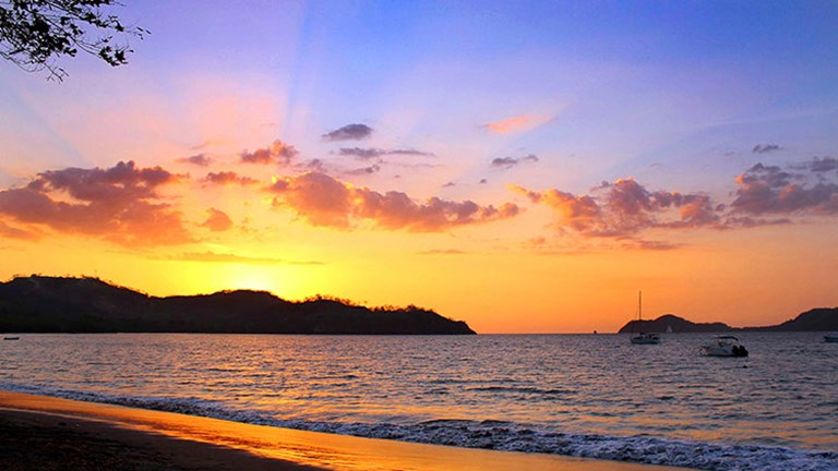 Guests at Guanacaste's El Mangroove Hotel can catch a stunning sunset on nearby Playa Panama beach. // © 2016 El Mangroove Hotel