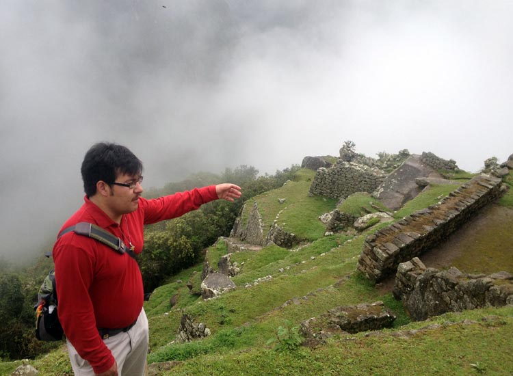 On Globus' Peru Splendors itinerary, guides provide important context to Incan ruins. // (c) 2013 Kenneth Shapiro