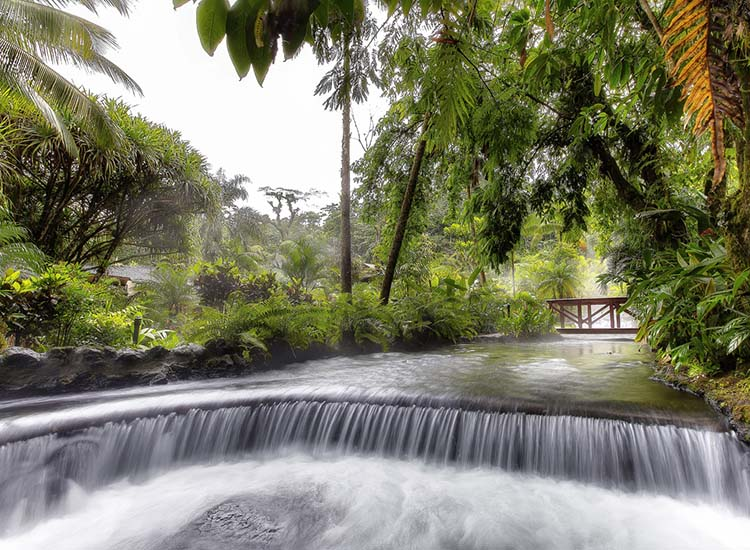The first hot springs in the area, Tabacon limits the number of non-hotel guests who may enter with a pass. // © 2017 Tabacon Thermal Resort & Spa