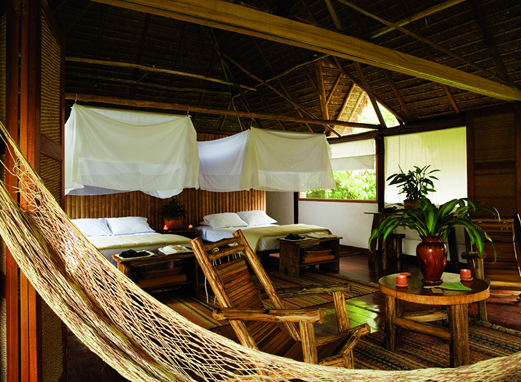 Embodying a luxurious safari feel, rooms at Inkaterra Reserva Amazonica are rustic chic.  // © 2014 Inkaterra