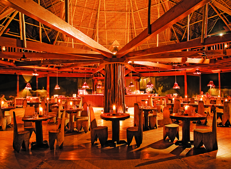 Guests can enjoy intimate, low-lit dining in Inkaterra Reserva Amazonica's main pavilion. // © 2014 Inkaterra