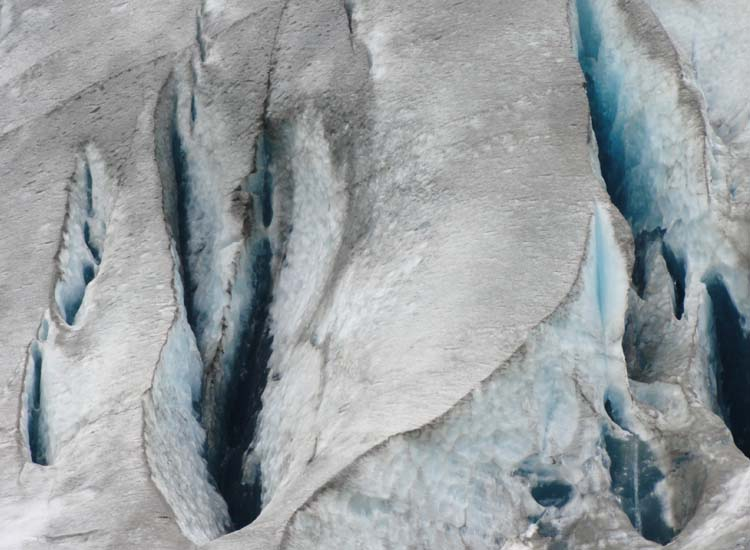 Ice in the glacier is likely hundreds of years old, and the blue color means that most of the air has been squeezed out by the weight of subsequent snowfalls.  // © 2014 Dennis Sides