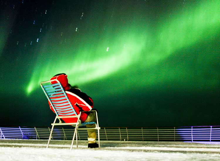 On any itinerary, the Northern Lights never fail to awe travelers.// © 2014 Lindblad Expeditions