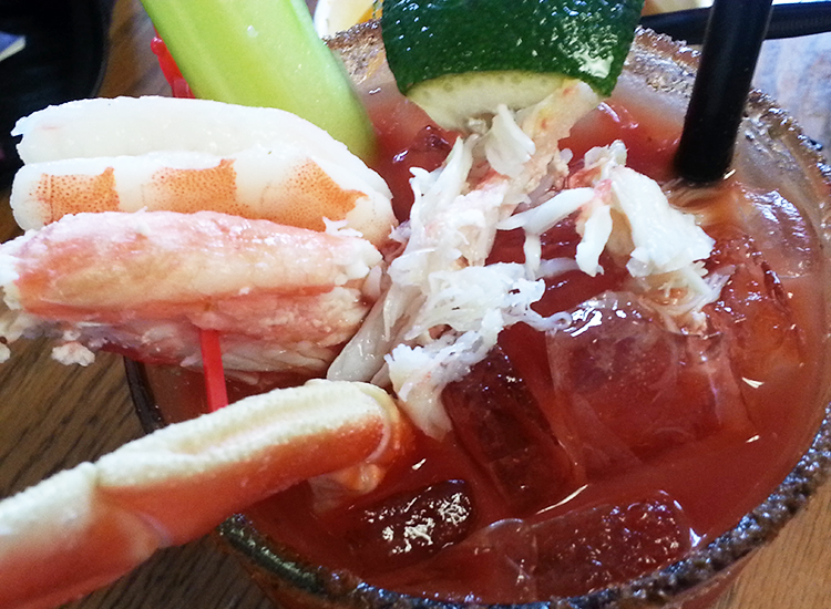 "The ""Crabby Bloody Mary,"" served with a whole shrimp and a crab leg, is a favorite among passengers. // © 2014 Monica Poling"