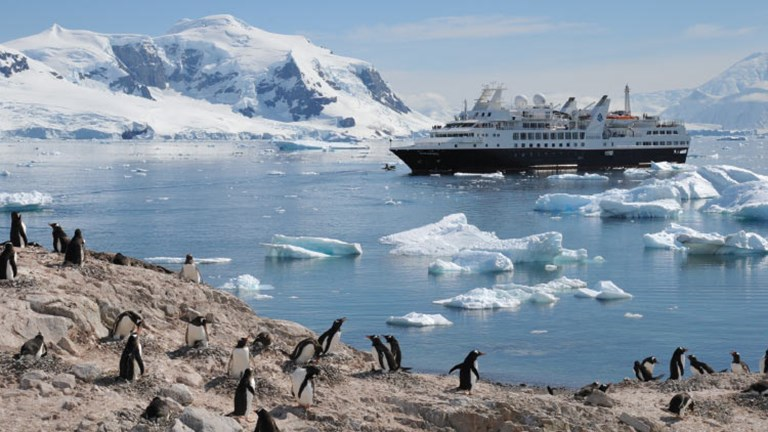 Silver Explorer prepares to meet penguins in Antarctica's Paradise Bay. // © 2016 Lindblad