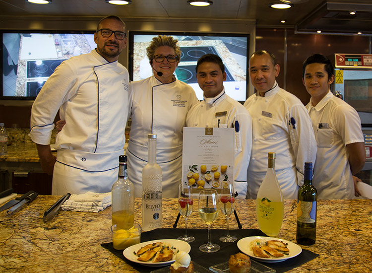 Chef Kathryn Kelly (center) and her team lead several intimate cooking classes per cruise. // © 2017 Mindy Poder