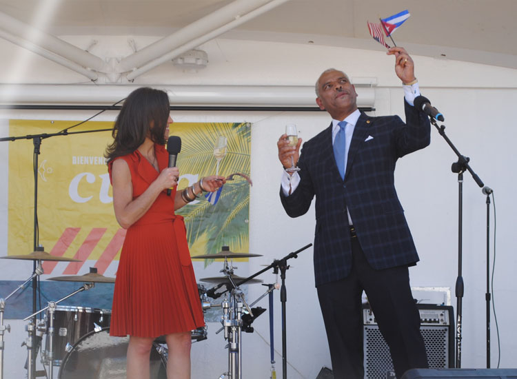 Arnold Donald, CEO of Carnival Corporation & Plc, and Tara Russell, Tara Russell, president of Fathom and global impact lead for Carnival Corporation & Plc, toasted the historic moment. // © 2016 Mindy Poder