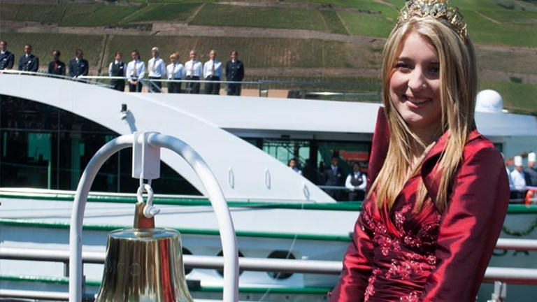 To celebrate the first ever ship inauguration for Bingen, the home of ice wine, Bingen's Ice Wine Princess was in attendance. // © 2014 Mindy Poder