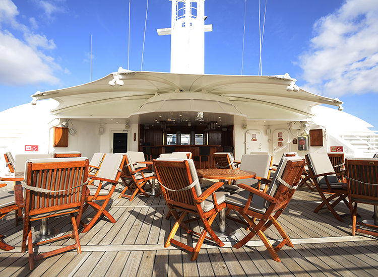 Guests can sip libations from Star Bar on the outdoor Star Deck, which was expanded by 4 feet on each side. // © 2016 Windstar Cruises