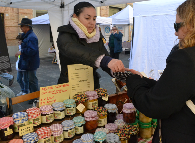 Slow Food Umbria's Earth Market in Umbertide features local vendors, such as this woman selling her mother's homemade jams. // (c) 2013 Mindy Poder