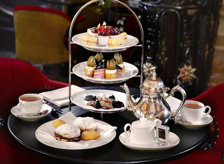 For a more luxurious experience, visitors to the Netherlands might sit down for afternoon tea at Hotel Des Indes, where a four-course affair of sweet and savory treats is served. // © 2014 Hotel Des Indes