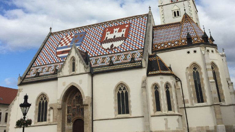 St. Mark's Church in Zagreb displays colorful coats of arms for the city and the Triune Kingdom of Croatia, Slavonia and Dalmatia. // © 2016 Megan Leader