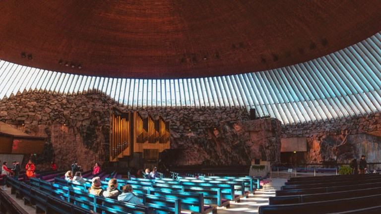 "Finland's Temppeliaukio church is commonly called the ""Rock Church"" because its walls are made entirely out of the rugged rock found underground in the area. // © 2017 iStock"