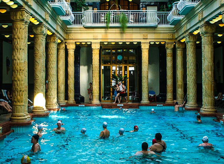 Soaking in the many baths of Budapest, such as the indoor swimming pool at Gellert, was thought to provide a bather with healing powers. // © 2016 Josalin Saffer