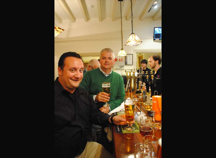 John Vavrina, vice president of sales for CIE, and Paul O'Meara, director of sales, New England for CIE, sample craft beers at Albion Ale House. // © 2014 Mindy Poder