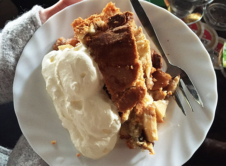Cafe Papeneiland is known for its made-from-scratch Dutch apple pie, pictured here with a big dollop of whipped cream. // © 2016 Valerie Chen