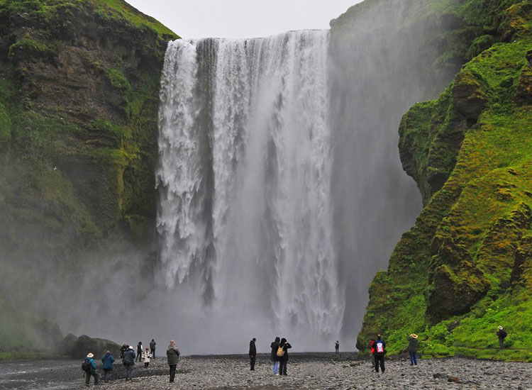 Skogafoss is one of the three waterfalls that guests can see on Discover Iceland's Discover the South Coast & Eyjafjallajokull Volcano tour. // © 2014 Discover Iceland