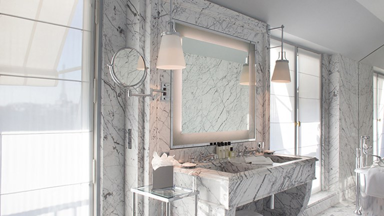 Bathrooms are outfitted with Carrara and Turquin blue marble. // © 2015 La Reserve Paris Hotel and Spa