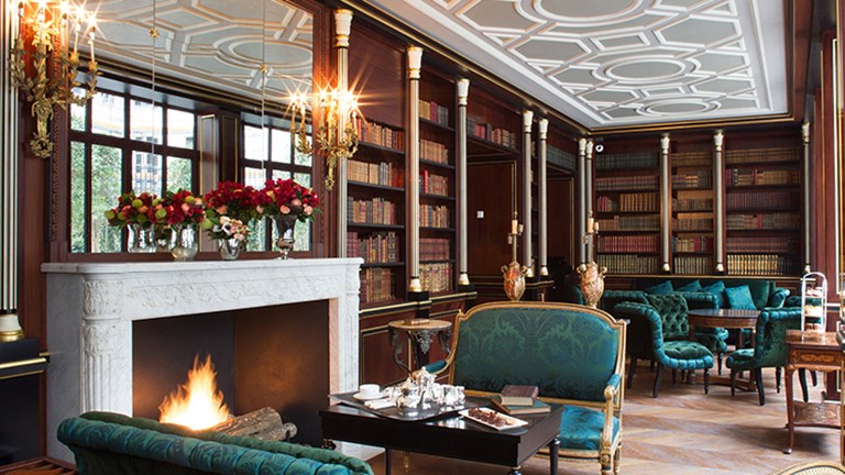 An on-site library stocked with antique books // © 2015 La Reserve Paris Hotel and Spa