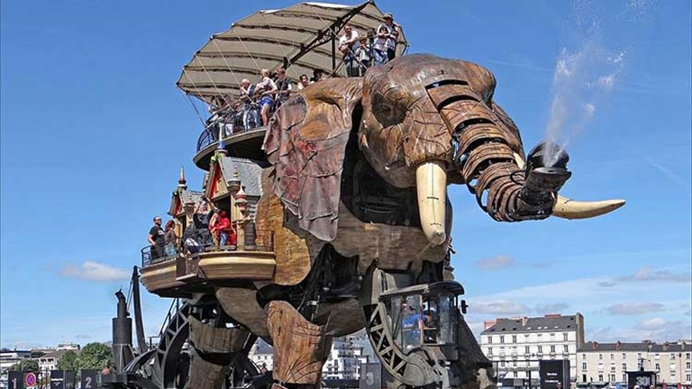 The tour of the city will continue with a visit to the Machines of the Isle of Nantes — an artistic contemporary exhibit featuring a gigantic, mechanical elephant. // © 2017 Creative Commons user dalbera