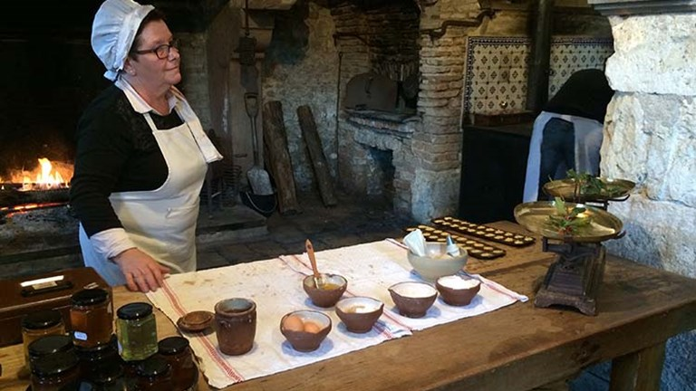 At the Chateau La Ferte Saint-Aubin, the cooks dress in traditional clothing as they demonstrate the art of baking French madeleine cookies. // © 2017 Giselle Abcarian